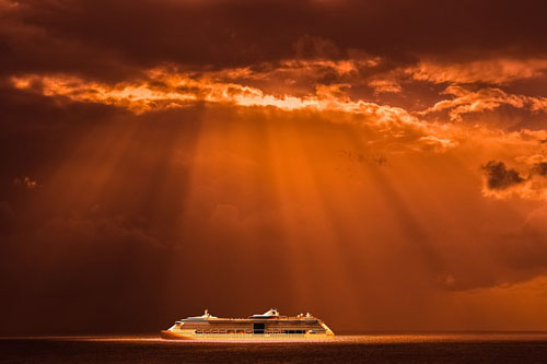 Cruise ship in rays of sun