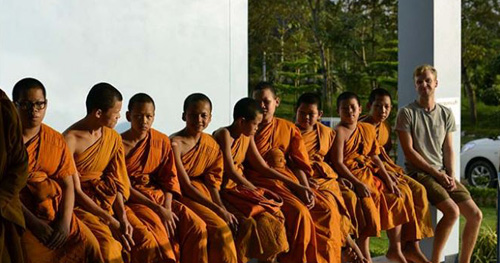 Tourist with monks, Thailand